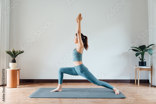 young asian beauty woman doing yoga at home