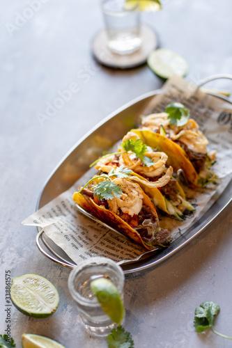 Obraz na płótnie Mexican meat tacos with tequila shots on stone background