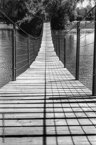 Narrow Footbridge Over Calm Lake Fototapet