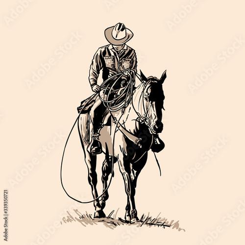 Fotografia American cowboy riding horse and throwing lasso.