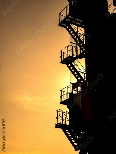 Canvastavla Low Angle View Of Silhouette Fire Escape Against Sky During Sunset