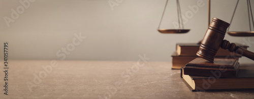 Photographie Wooden gavel with scales of justice and books on lawyer's table, space for text
