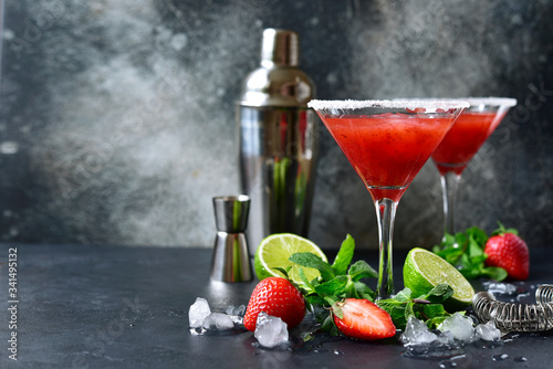 Cold summer strawberry cocktail with lime and mint ( mojito, margarita, rossini,daiquiri ) in a martini glasses Poster Mural XXL