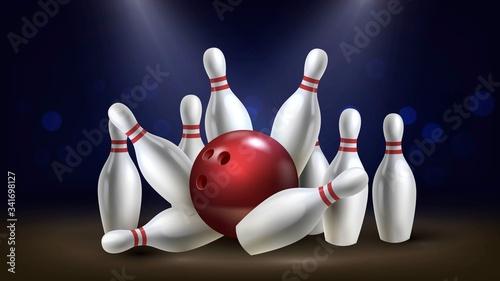 Slika na platnu Red shiny bowling ball breaks white skittles on a dark background, winning hit