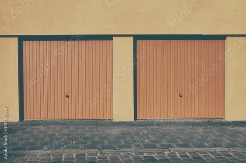 Fototapeta Symmetrical View Of Two Garages