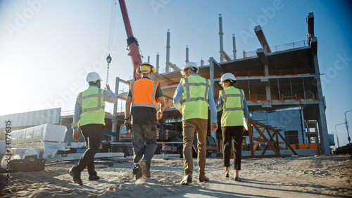 Fotografia Diverse Team of Specialists Inspect Commercial, Industrial Building Construction Site