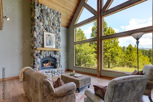 Fototapeta Beautiful large bright country American home interiors of living room