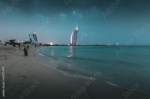Canvas Print Burj al Arab and Jumeirah beach at dusk Dubai - UAE