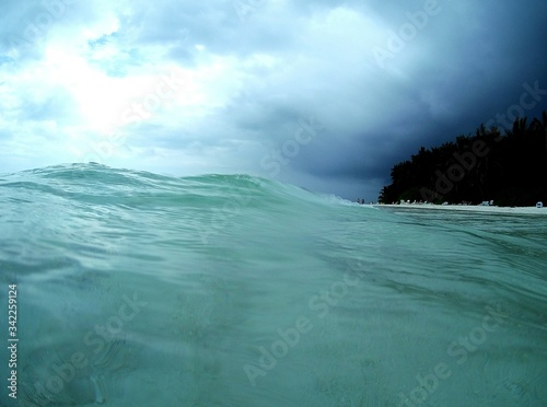 Close-up Of Wave On Sea Against Cloudy Sky Fototapeta