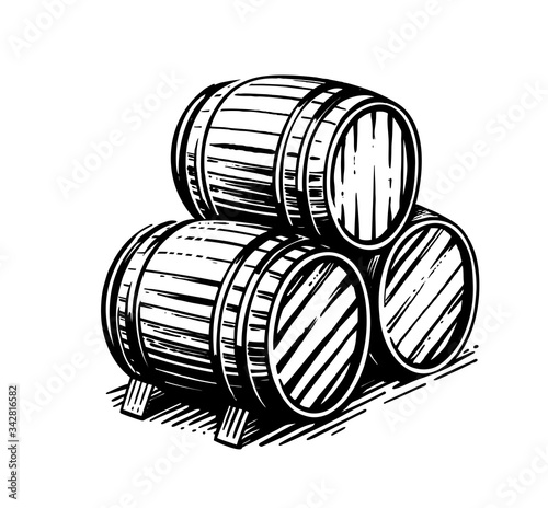 Foto three wooden barrels for wine and other alcohol