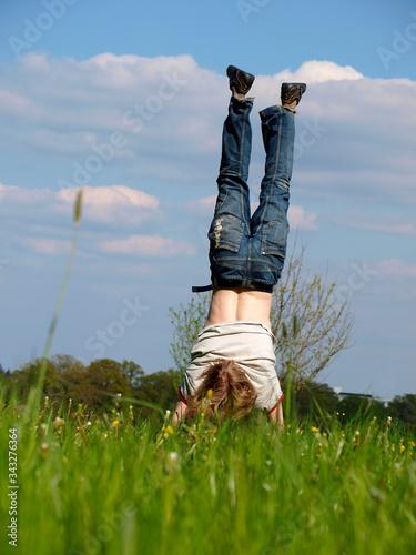 Rear View Of Boy Performing Handstand On Landscape Fototapet