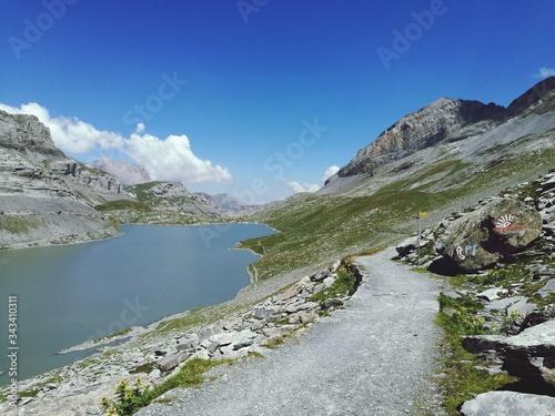 Obraz na płótnie Scenic View Of River Amidst Mountains Against Sky