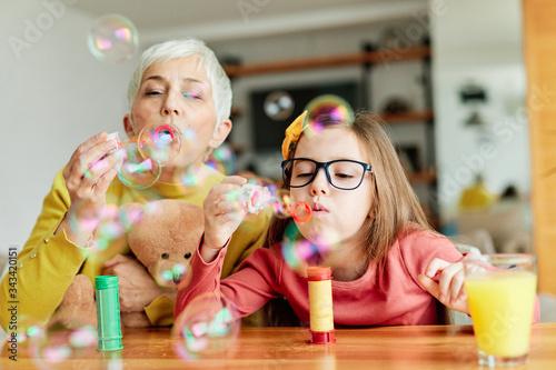 Fotografia, Obraz grandchild granddaughter grandma grandmother girl love family blowing soap bubbl