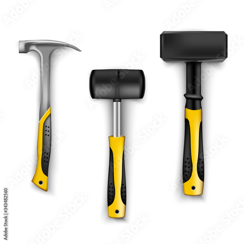 Fotografie, Tablou set of construction hammers in different sizes, metal and rubber for tiles with rubber black and yellow handles