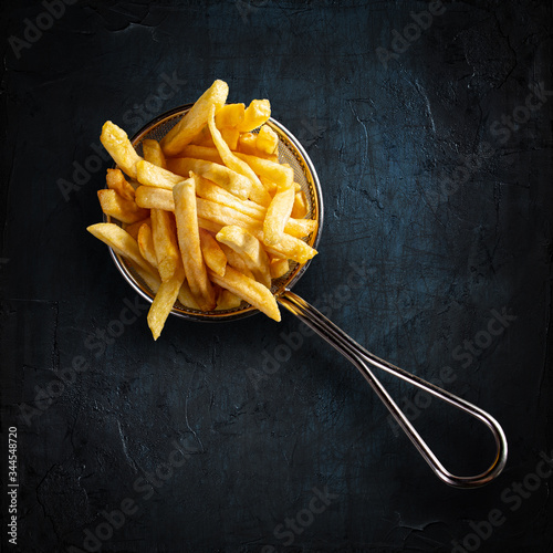 French fries in fancy metal basket Fototapeta
