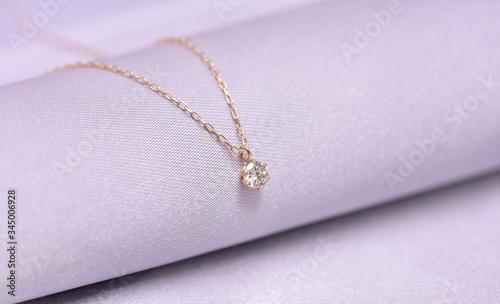 Fotografie, Obraz diamond necklace on a silk background