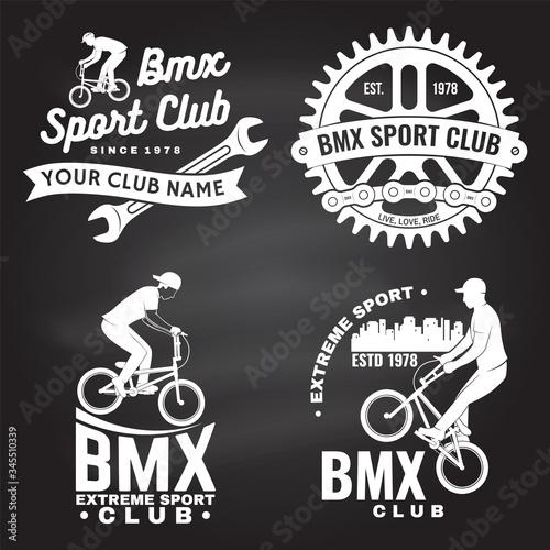 Fotografija Set of bmx extreme sport club badge on chalkboard