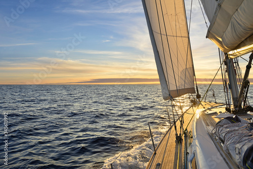 Stampa su Tela Sailboat sailing in the Mediterranean Sea at sunset