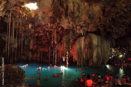 Fototapeta Tourists Swimming In Cenote Of Dzitnup Village Near Valladolid