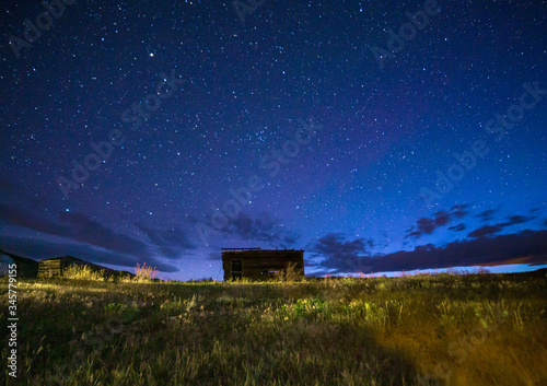 Fotografie, Tablou abandoned shack at night, starry sky