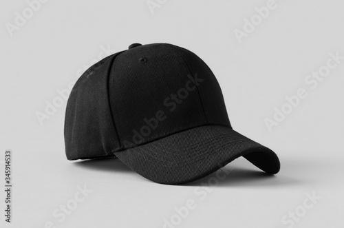 Obraz na plátně Black baseball cap mockup on a grey background.