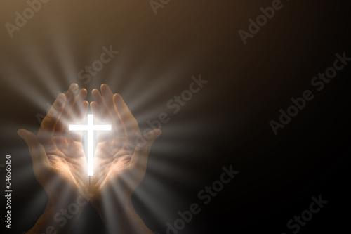 Fototapeta Man hands praying in dark background