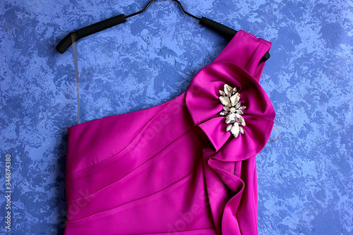 Canvas Print Off-shoulder evening gown, magenta fuchsia, with flower brooch and crystals on t