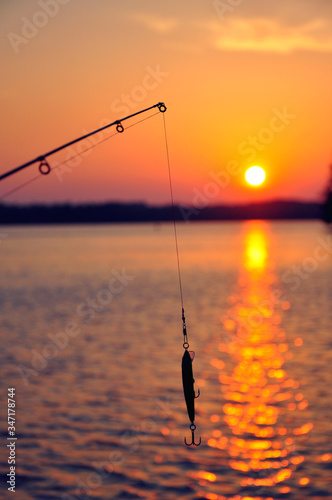 Leinwand Poster Fishing Rod Over Sea Against Sky During Sunset