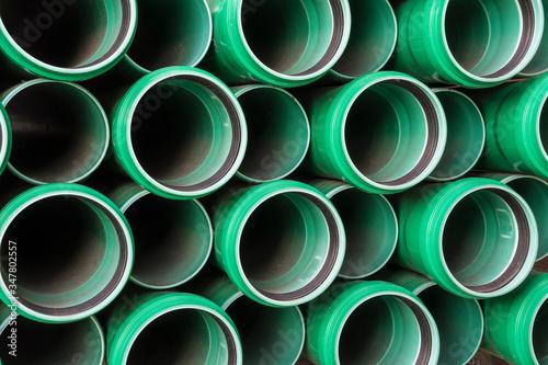 Fotografie, Obraz stack of green plastic pipes