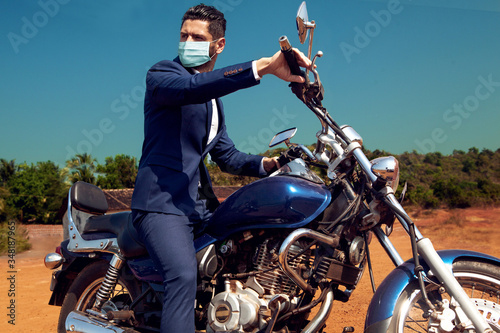 Photo Man in face mask on motorcycle in suite