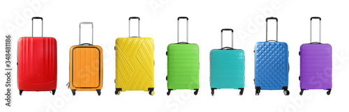 Photo Set of different colorful suitcases on white background