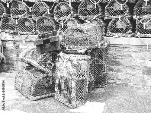 Fotografie, Tablou Lobster Traps On Wall And Footpath