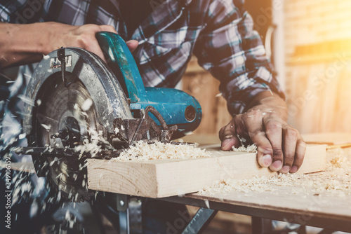 Carpenter working on wood craft at workshop to produce construction material or wooden furniture Tapéta, Fotótapéta