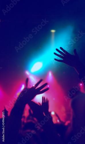 Obraz na plátně Silhouette Hand Of People Enjoying In Nightclub