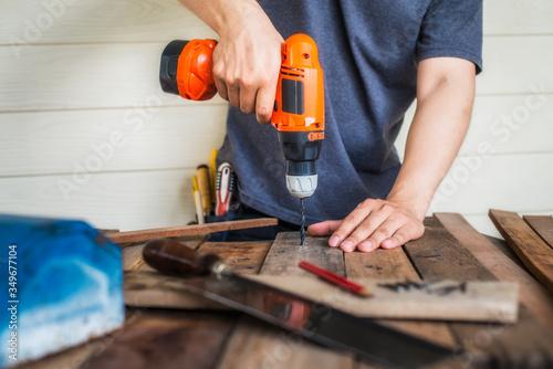 Canvastavla Midsection Of Carpenter Drilling Wood At Workshop