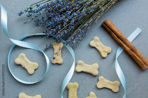 Leinwand Poster Dog Biscuits With Cinnamon And Lavender On Gray Background