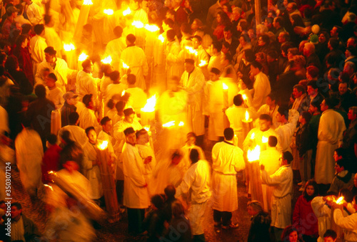 Fotografia High Angle View Of Priests Holding Candles At Event