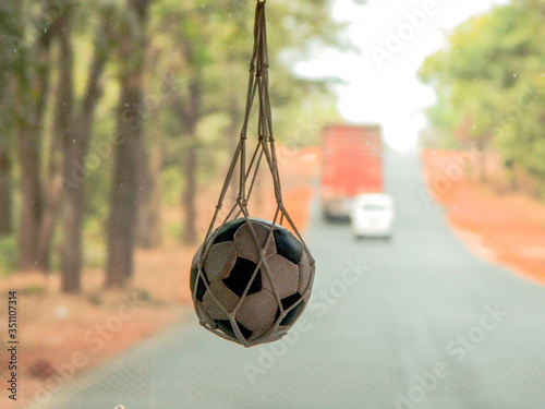 Close-up Of Ball Hanging By Windshield