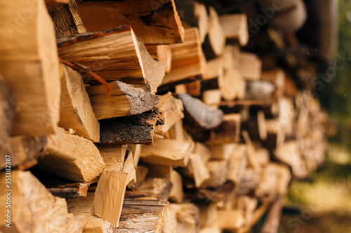 Fototapeta Closeup of chopped firewood in a stack ready for burning.