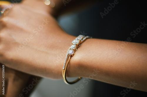 Fotografia, Obraz Cropped Hands Of Woman Wearing Bangle