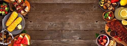 Fotografering Summer BBQ or picnic food double side border over a rustic wood banner background