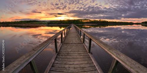 Empty Footbridge Over Lake Against Sky Fototapet