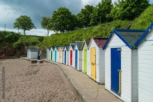 Multi Colored Huts On Beach Fototapet