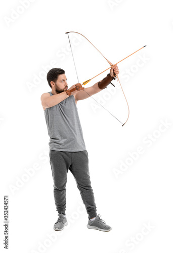 Handsome man with crossbow on white background Fotobehang