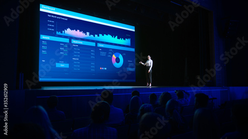 Canvas Print Business Forum Economics Conference Stage: Visionary Female Chief Analyst Delivers Speech and Shows Infographics, Statistics on Movie Theater Screen