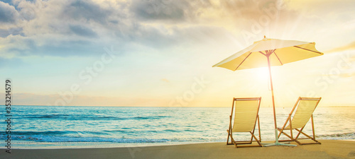 Fotografia Background with couple of deck chairs at sunset, Travel concept, Summer backgrou