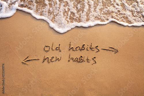 Wallpaper Mural old habits vs new habits, life change concept written on sand