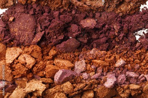 Obraz na plátne Background of smashed colored eyeshadows pigments close up