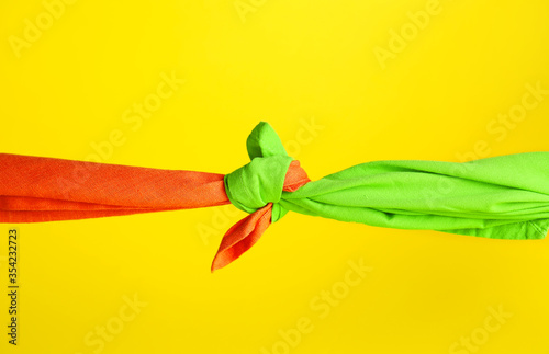 Fotografia Tied handkerchiefs on color background. Unity concept