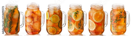 Photographie Iced tea with lemon, lime, thyme, rosemary in a mason jars, isolated